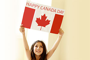 A Little Girl Holding Happy Canada Day Flag!